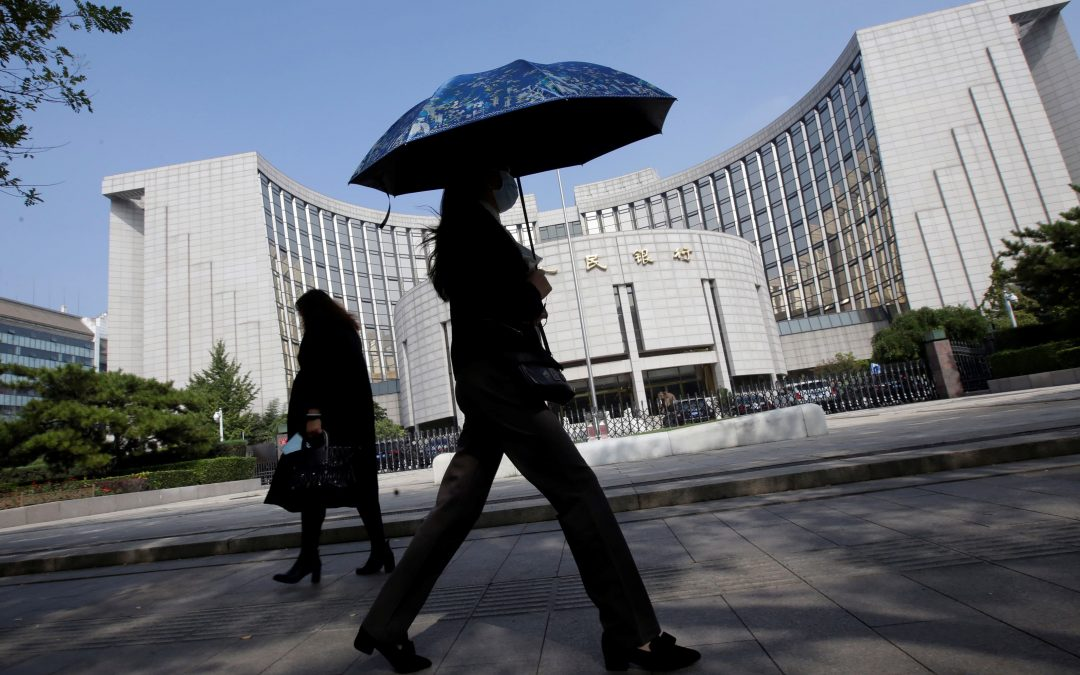 China's central bank warns of financial risks, including defaults